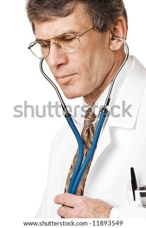Caring Doctor listening through stethoscope. Closeup, isolated on white - stock photo
