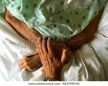 Caring for an elderly man in the hospital.