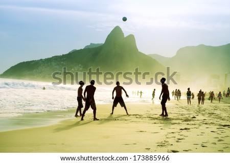 Carioca Brazilians playing altinho futebol beach football kicking soccer ball Ipanema Beach Rio de Janeiro  - stock photo