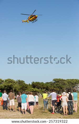 Carnac, France - August 10: View of a french rescue helicopter near Carnac, France on August 10, 2014. - stock photo