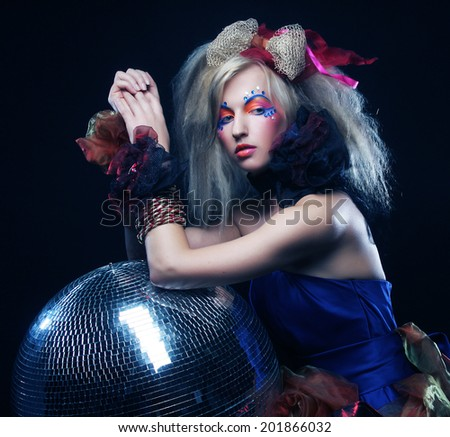carnaval girl with disco ball - stock photo