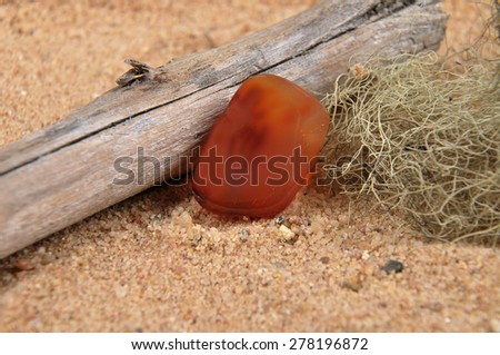 Carnelian on beach - stock photo