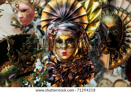Carnevale masks on sale at a market in Venice, Italy. The masks are popular tourist souvenirs. - stock photo
