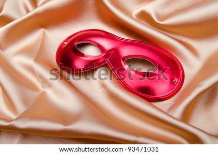 Carnical mask on satin background - stock photo