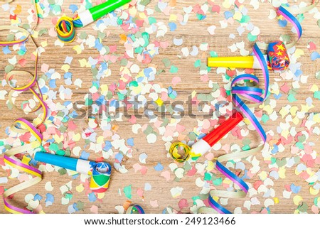 carnival background with confetti and paper streamer - stock photo