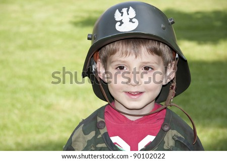 Carnival costume. Little Polish soldier. - stock photo