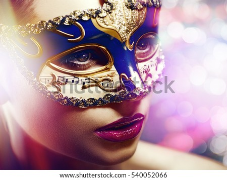 Carnival. Fantastic female portrait with shine light and beauty bokeh