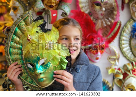 Carnival in Venice, Italy. Portrait of beautiful girl with venetian mask. - stock photo