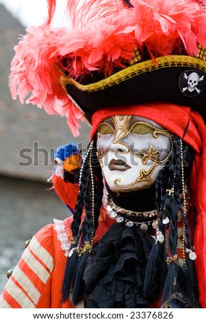 Carnival in venice with model dressed in various costumes and masks - pirate