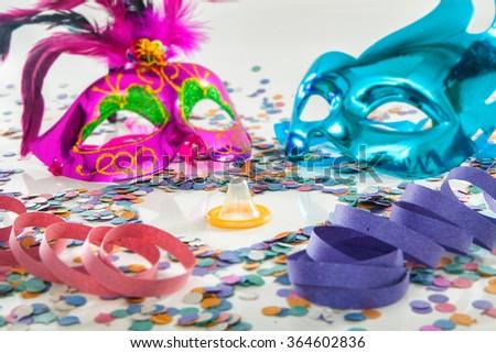 Carnival love protection theme - Condom (contraceptive rubber) - stock photo