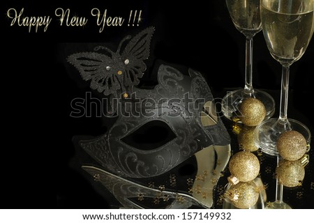 Carnival mask  and champagne on black background