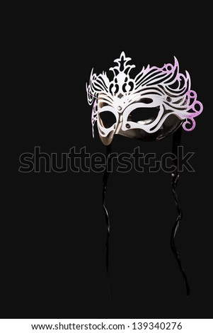 Carnival mask on a black background. - stock photo