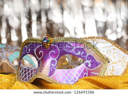 Carnival mask on golden material background - stock photo