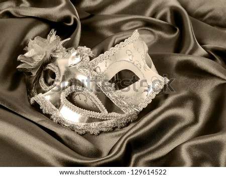 carnival masks on silk fabric, black and white