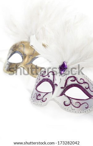 Carnival masks  with feathers on white background - stock photo