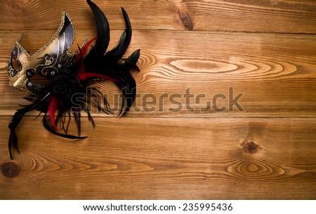 Carnival masquerade mask on a wooden table  - stock photo