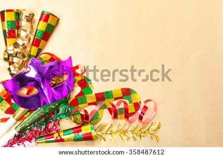 Carnival party mask and decorations. Mardi gras. Colorful holidays background - stock photo