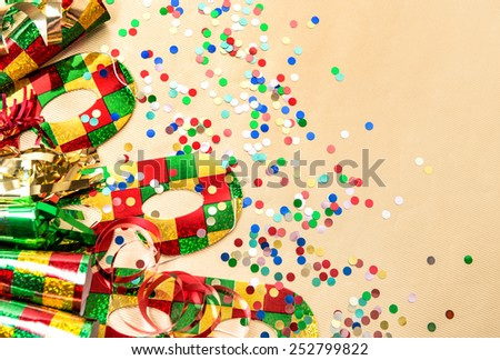 Carnival party masks and decorations. Colorful holidays background - stock photo