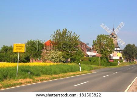 carolinensiel with windmill - stock photo