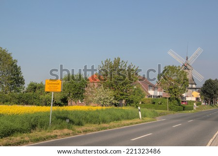 carolinensiel with windmill - stock photo