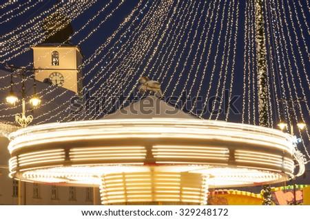 Carousel at Christmas fair in Sibiu, Transylvania, Romania - stock photo