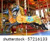 Carousel Horses on a Traditional Fun Fair Ride. - stock photo
