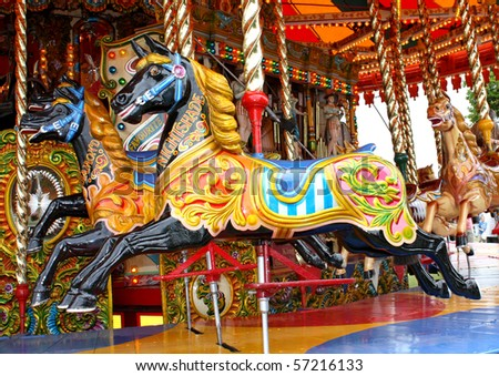 Carousel Horses on a Traditional Fun Fair Ride. - stock photo