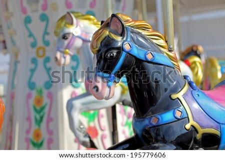 Carousel in an Amusement Park - stock photo