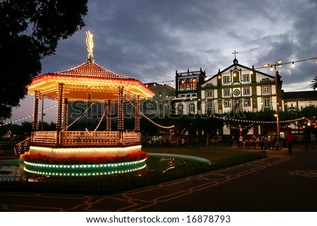 Carousel in front of the church - stock photo