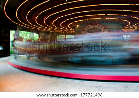 Carousel in motion through a ride in Central Park, NYC - stock photo