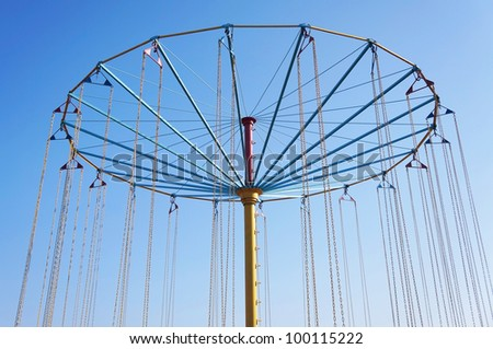 carousel on a background blue sky - stock photo