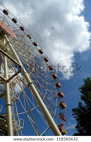 Carousel, Turning Carousel detail, close up with the blue sky background in Minsk, Belarus. Summer activities. Minsk, Belarus, East Europe, city scene. Technology.