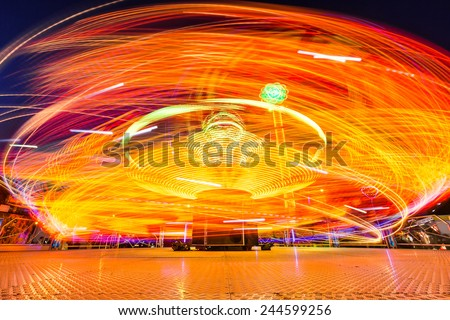 Carousels at night. Long time exposure - stock photo