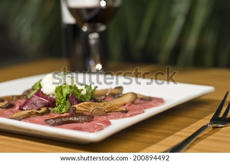 Carpaccio and red wine - stock photo