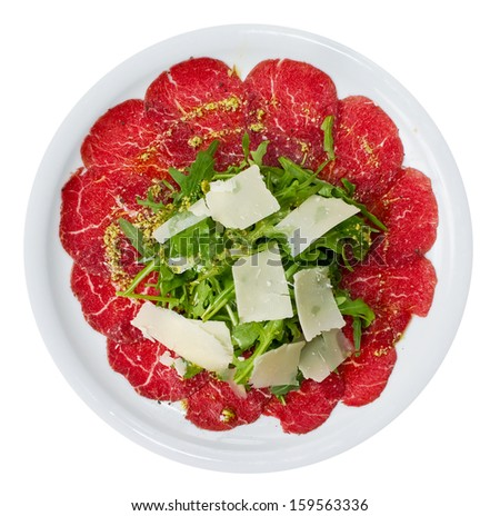 Carpaccio is a dish of raw meat  (such as beef, veal or venison), thinly sliced or pounded thin and served mainly as an appetizer. - stock photo