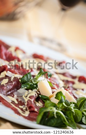 carpaccio with rucola, parmesan cheese and mayonnaise sauce - stock photo