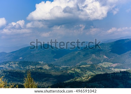 Carpathian Mountains in Summer. Beautiful nature landscape with mountains, trees and blue sky with clouds