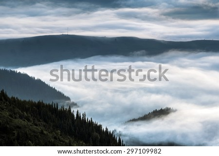 Carpathian Mountains. Mountains covered in mist at sunrise