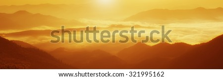 Carpathian mountains summer golden sunrise landscape with  foggy river - panoramic view - stock photo