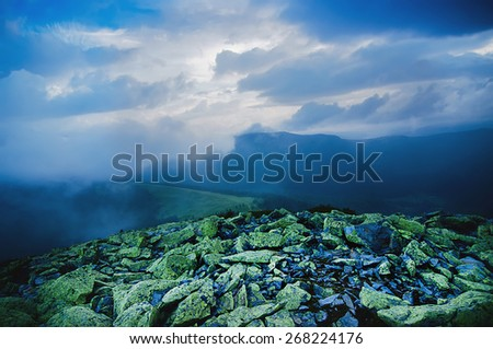 Carpathian mountains summer  landscape with dramatic clouds and mossy stones - stock photo