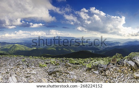 Carpathian mountains summer  landscape with dramatic clouds, panoramic view
