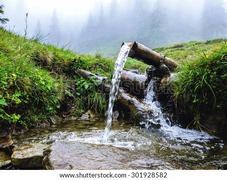 Carpathians, source of spring fresh water. Near mount Petros - stock photo