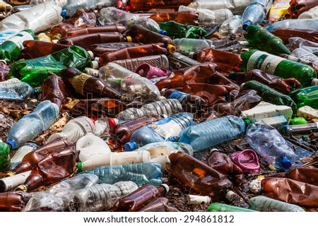 CARPATHIANS, UKRAINE - MAY 03, 2015: plastic bottles and trash in the river water - stock photo