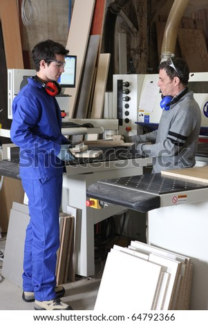Carpenter and apprentice - stock photo