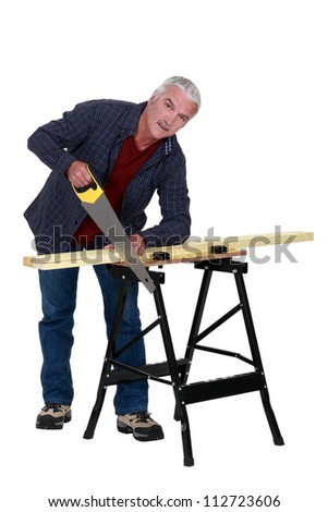 Carpenter at a workbench - stock photo
