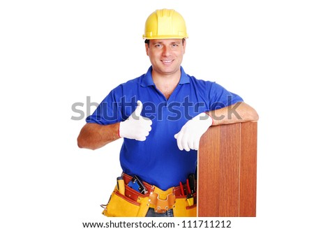 Carpenter holding the floor panel on white background showing thumbs up closeup portrait - stock photo