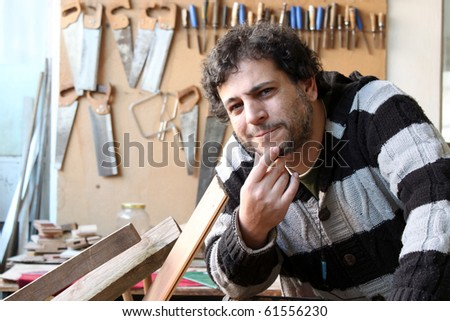 carpenter in the carpentry - stock photo