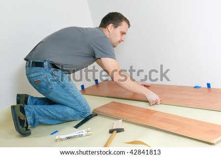 Carpenter laying laminate floor