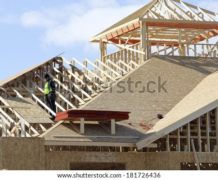 carpenter on a roof of a  new constructon complex