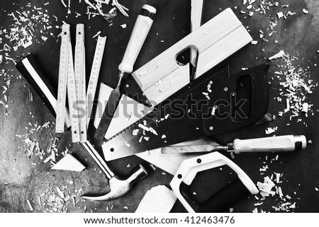 carpenter's tools close up on work bench - stock photo